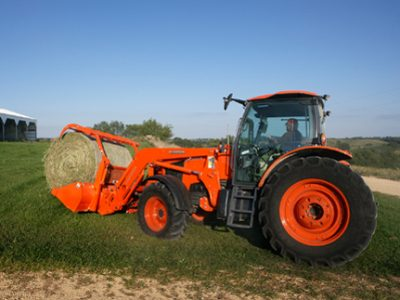 M135 tractor with hay grapple